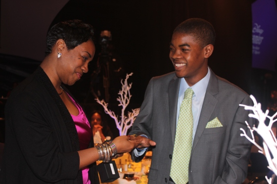 Marcus Burns (Jacksonville) receives graduation ring from mom at commencement