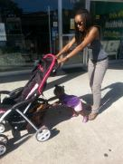 Kelsey and Journey pushing stroller